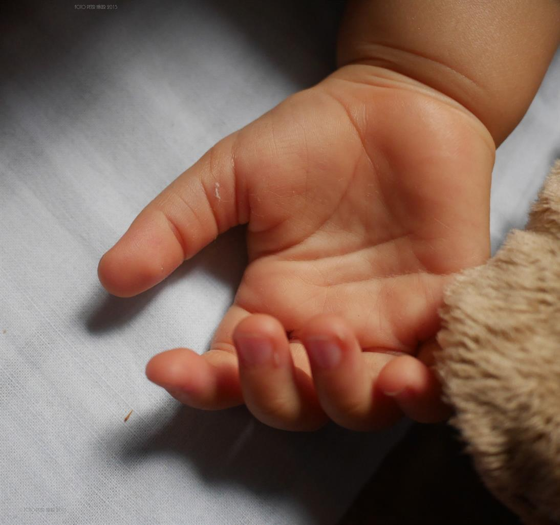 The outstretched palm of a young boy.